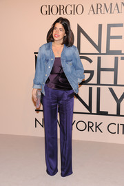 Leandra Medine contrasted her casual jean jacket with a pair of elegant blue silk pants when she attended the Giorgio Armani SuperPier show.