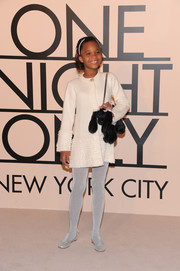 Quvenzhane Wallis looked darling at the Giorgio Armani SuperPier show in a white Armani sweater dress embellished with tiny ruffles.