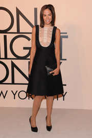Allison Sarofim wore a lovely black cocktail dress with white lace bib detail to the Giorgio Armani SuperPier show.