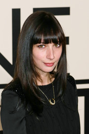 Rebecca Dayan styled her tresses in sleek layers with blunt bangs for the Giorgio Armani SuperPier show.