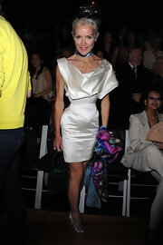 Daphne Guinness added sparkle to her step in fashion forward glittery silver wedge heels.