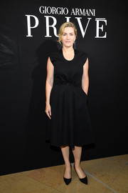 Kate Winslet kept it simple and classic in a little black dress at the Armani Prive fashion show.