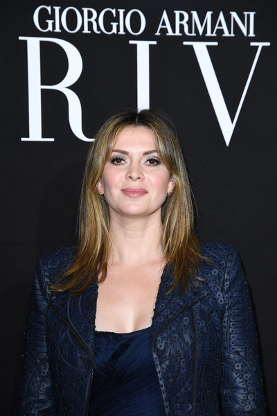 Carly Steel sported a center-parted layered cut at the Armani Prive fashion show.