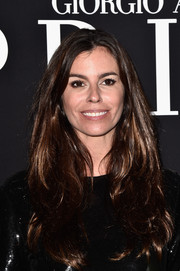 Christina Pitanguy wore her tresses down in long, layered waves during the Giorgio Armani Prive show.