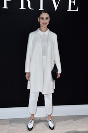 Olga Kurylenko went for a preppy vibe in an all-white coat, collared shirt, and textured trousers combo at the Armani Prive fashion show.