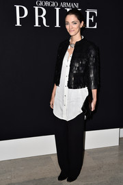 Sofia Sanchez Barrenechea looked ultra stylish in a cropped black leather jacket layered over an oversized white button-down at the Giorgio Armani Prive show.
