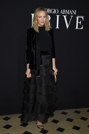 Uma Thurman attended the Armani Prive fashion show wearing an elegant black velvet blazer.