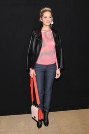 Marion Cotillard topped off her casual and edgy outfit with a black leather jacket.
