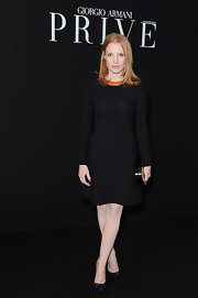 Jessica Chastain topped off her chic black dress at the Armani Prive show with black embellished pumps.