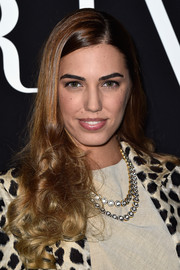 Amber Le Bon channeled Barbie with this ultra-feminine curly hairstyle at the Giorgio Armani Prive show.
