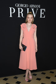 Dakota Fanning looked romantic in a peach V-neck dress with layered shoulders at the Armani Prive fashion show.