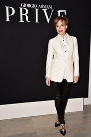 Kristin Scott Thomas went the menswear-chic route with this white blazer and button-down combo at the Giorgio Armani Prive show.
