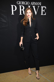 Barbara Palvin polished off her look with silver slim-strap sandals.