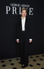 Amber Heard went androgynous in a black tuxedo at the Armani Prive fashion show.
