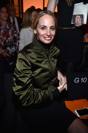 Lauren Santo Domingo looked trendy in an army-green bomber jacket at the Armani Prive fashion show.