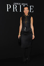 Roberta Armani wore a bold statement necklace to the Armani Prive show in Paris.