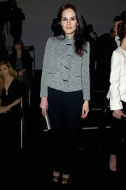 Michelle Dockery maintained a simple aesthetic at the Giorgio Armani Prive show in a black-and-white toggle jacket.