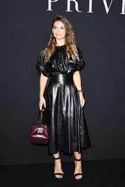 The leather-clad beauty finished off her look with a black midi skirt.