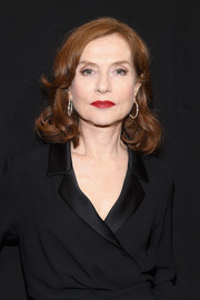 Isabelle Huppert sported a short hairstyle with curly ends at the Armani Prive fashion show.