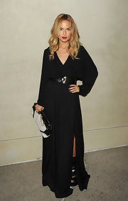 Rachel Zoe accessorized her black maxi dress with a black and white clutch complete with gold hardware.
