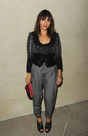 Rashida Jones completed her eclectic ensemble with a red satin clutch complete with gold hardware.