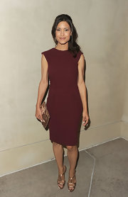 Julia Jones looked lovely in a maroon cocktail dress with a simple sheath silhouette.