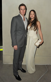 Devon Aoki looked ultra chic with hubby James bailey at the Georgio Armani/'Vanity Fair' soiree in LA. She accessorized her look with a satin ivory clutch.