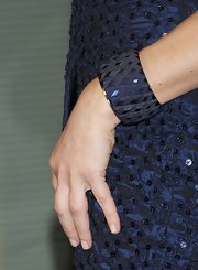 Roberta Armani paired her sequined navy dress with a matching chunky bangle bracelet.