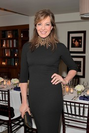 Allison Janney paired a black satin clutch with an embellished LBD for the Stuart Weitzman Beverly Hills boutique opening.