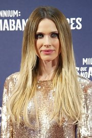Vanessa Romero wore her long golden tresses with a simple center part at the premiere of 'The Girl With the Dragon Tattoo' in Madrid, Spain.