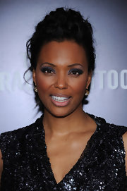 Aisha Tyler wore sultry smoky shades of gray shadow and lots of liner and mascara at the NYC premiere of 'The Girl With the Dragon Tattoo.'