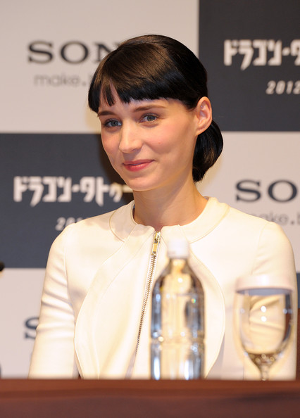 Rooney Mara wore her sleek pageboy drawn back into a low ponytail during a press conference for 'The Girl With the Dragon Tattoo.'