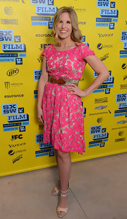 Kathleen Christy chose a fun and flirty pink lace dress with gold buckle belt for her look at SXSW 2013.