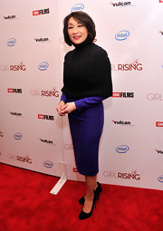 Connie Chung looked sophisticated and mature in a purple cocktail dress, which she paired with a black sweater shrug.