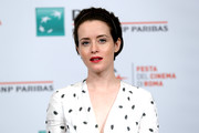 Claire Foy sported a mildly messy 'do, which she tried to tame with a headband, at the Rome Film Fest photocall for 'The Girl in the Spider's Web.'