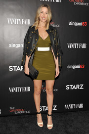 Melissa Bolona styled her dress with a gold-buttoned black leather jacket.