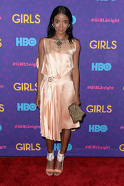 Genevieve Jones styled her dress with a pair of two-tone sandals featuring wide ankle straps.