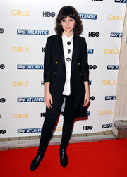 Felicity Jones kept it season-appropriate in a black wool coat during the 'Girls' season 3 premiere in London.