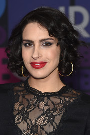 Desiree Akhavan attended the 'Girls' season 4 premiere wearing her hair in sweet, bouncy curls.