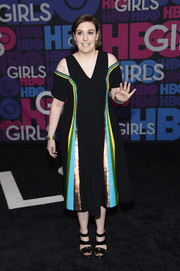 Lena Dunham chose black strappy sandals to team with her vibrant dress.