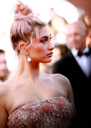 Hailey Baldwin sported a messy-chic top knot at the Cannes Film Festival screening of 'Girls of the Sun.'