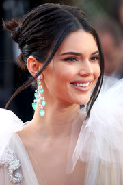 Kendall Jenner went edgy-glam with this twisted bun at the Cannes Film Festival screening of 'Girls of the Sun.'