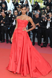 Jasmine Tookes glammed it up in a strapless red ball gown by Zac Posen at the Cannes Film Festival screening of 'Girls of the Sun.'