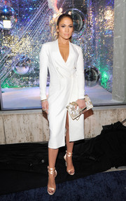 Jennifer Lopez styled her LWD with a pair of strappy champagne sandals by Giuseppe for Jennifer Lopez.