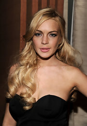 Lindsay Lohan brought out the glamour with bouncy curls, which she pinned up in a half up hairstyle.