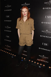 Karen wears a camel romper over tights for the Givenchy party in Paris.