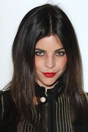 Julia Restoin-Roitfeld stuck to her usual center-parted style when she attended the Givenchy fashion show.