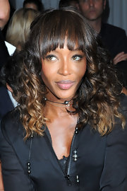 At the Givenchy fashion show in Paris, Naomi Campbell kept her makeup look ultra simple with a sweep of smoky eyeshadow and lip gloss.