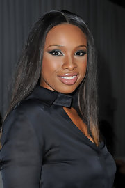 Jennifer Hudson wore shimmery shades of shadow at the Givenchy fashion show in Paris. To try her look at home begin by sweeping black eye pencil along the top and bottom lash lines and on the inner rims of eyes. Next, apply a metallic gunmetal gray shadow to upper lids and blend up into the creases. Then add a softer metallic sliver shadow to the inner corners of the eyes and under the brow bone. To finish this super hot look, apply several coats of a volumizing mascara.