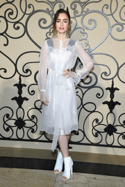 Lily Collins contrasted her delicate dress with edgy white peep-toe boots.